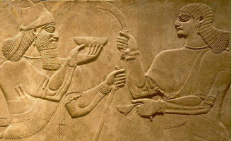 Relief panel of two figures engaged in an offering ceremony (Courtesy metmuseum.org)